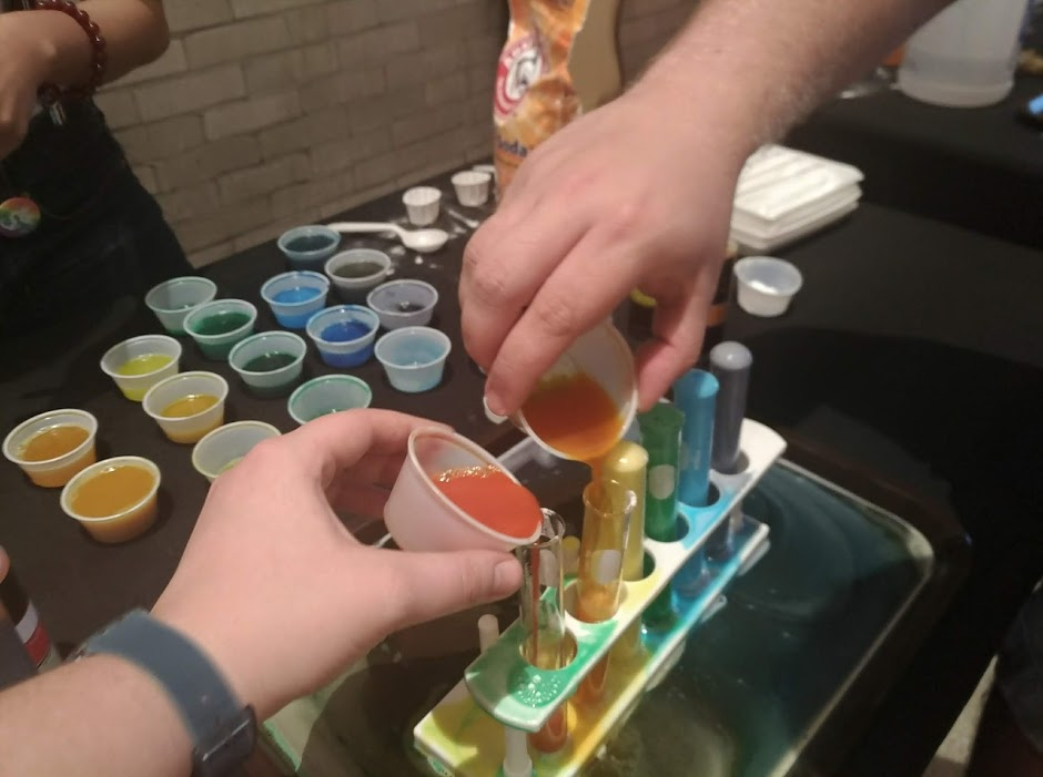 Creating a colorful reaction at the Pride Science After Hours event.